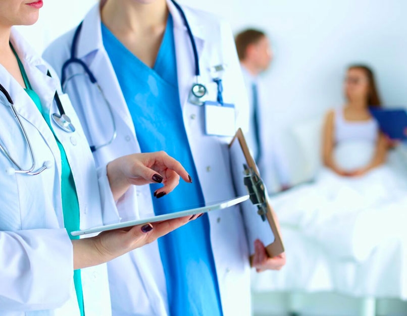 nursing professionals looking at tablet