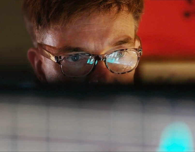 close up, person looking at computer screen