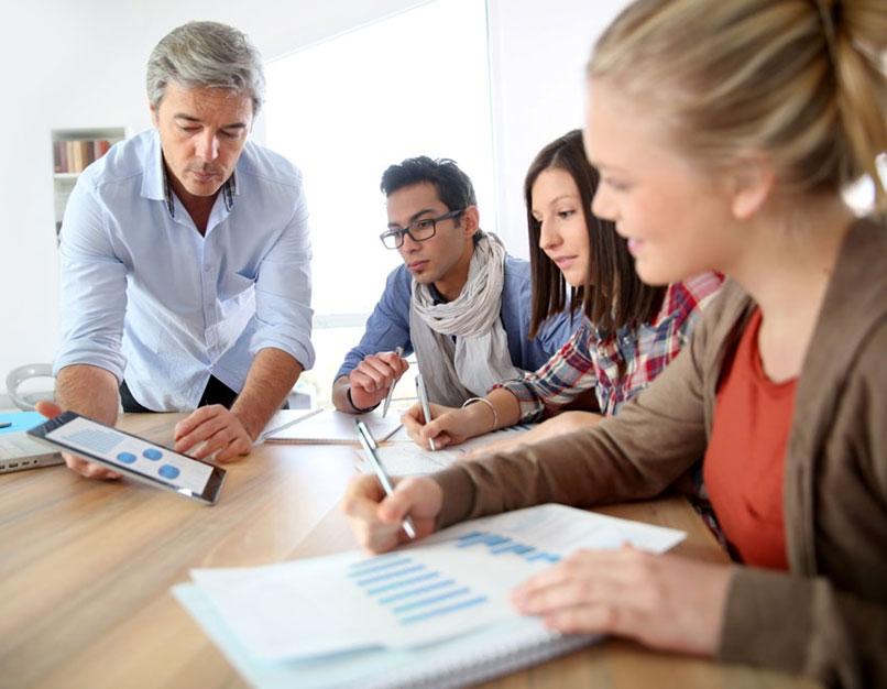 team meeting, looking at tablet