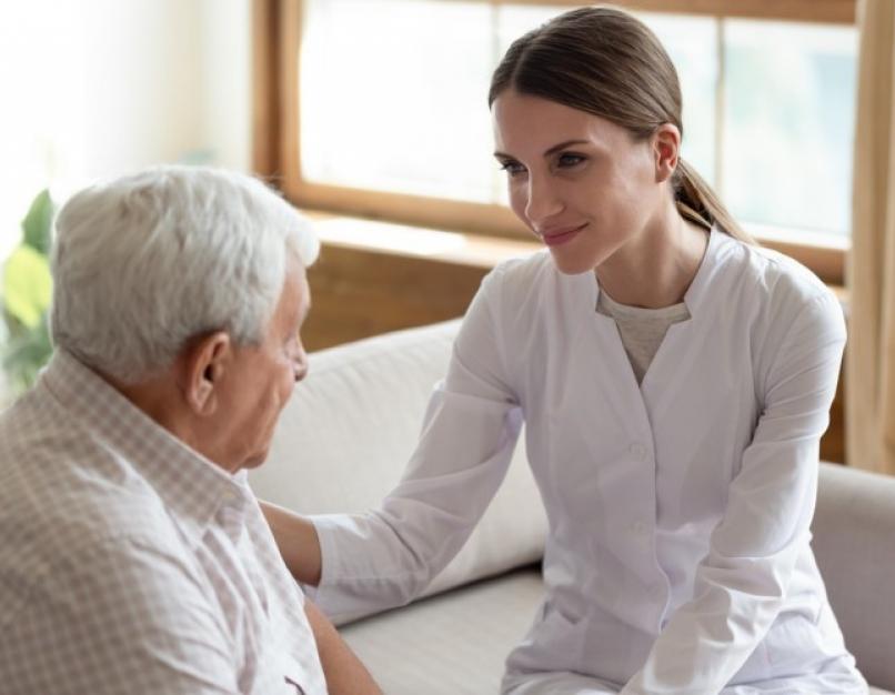 A nurse meets with a patient.