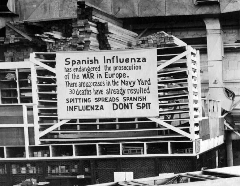 "A 1918 warning sign at the Naval Aircraft Factory in Philadelphia that begins, ""Spanish Influenza has endangered the prosecution of the war in Europe."""